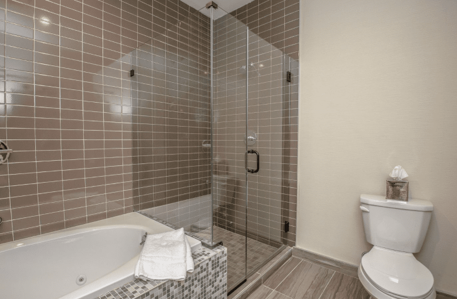 Chandler Three Room Granite Suite bathroom with whirlpool tub and walk in shower